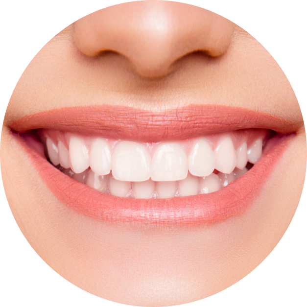A woman smiles and shows the results of cosmetic dentistry.