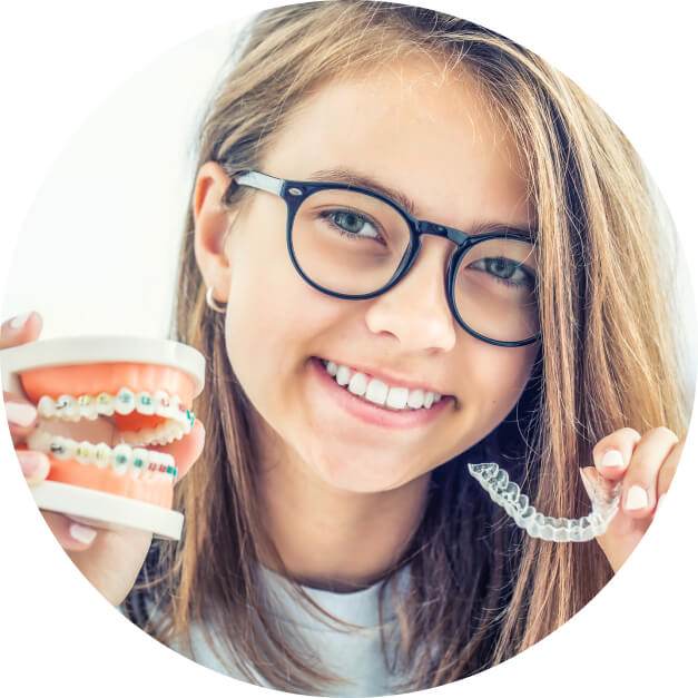 A young girl shows off cosmetic dentistry treatments for teens.
